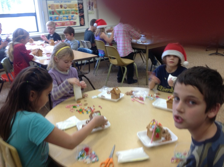 Bridge Lake Elementary students decorate gingerbread houses.