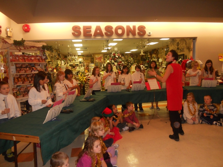 Teacher Leslie Dickson leads Buffalo Creek Elementary's handbell choir at the Cariboo Mall in 100 Mile House.
