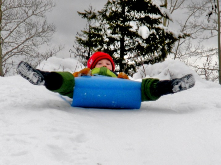 A Forest Grove Elementary student zooms down the school sledding hill.