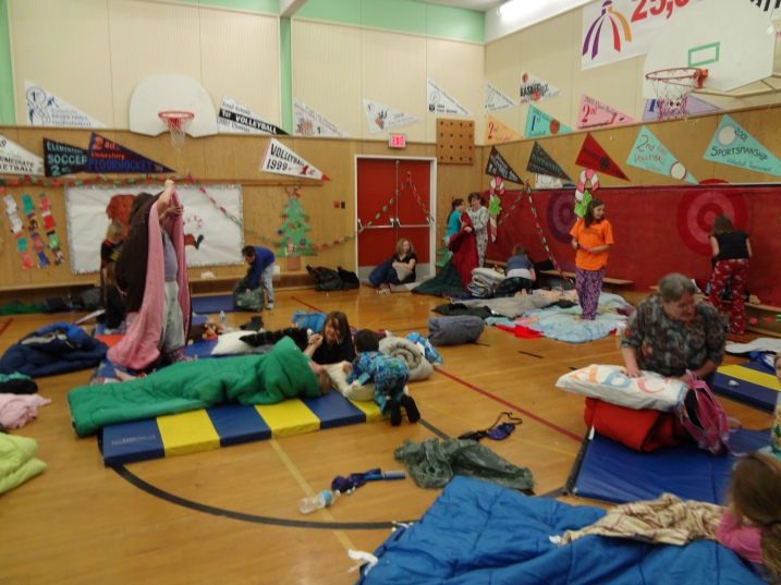 Lac La Hache Elementary students clean up after their Christmas sleepover at the school.