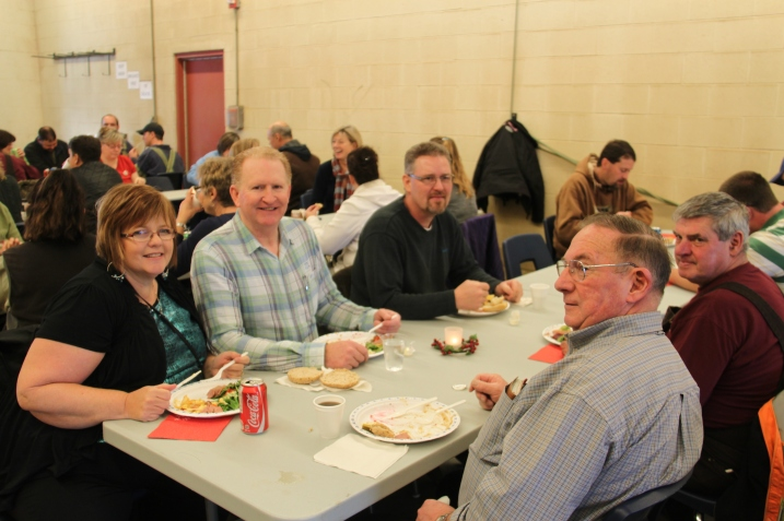 "District staff enjoy the annual Christmas potluck at the Williams Lake Bus Garage.  Pictured left to right are Connee Newberry (Executive Assistant), Richard des Ormeaux, (Assistant Manager of Facilities & Transportation), Alex Telford (Manager of Facilities & Transportation), Norm Leslie (school bus driver) & ""Poncho"" Forseille (grounds)"