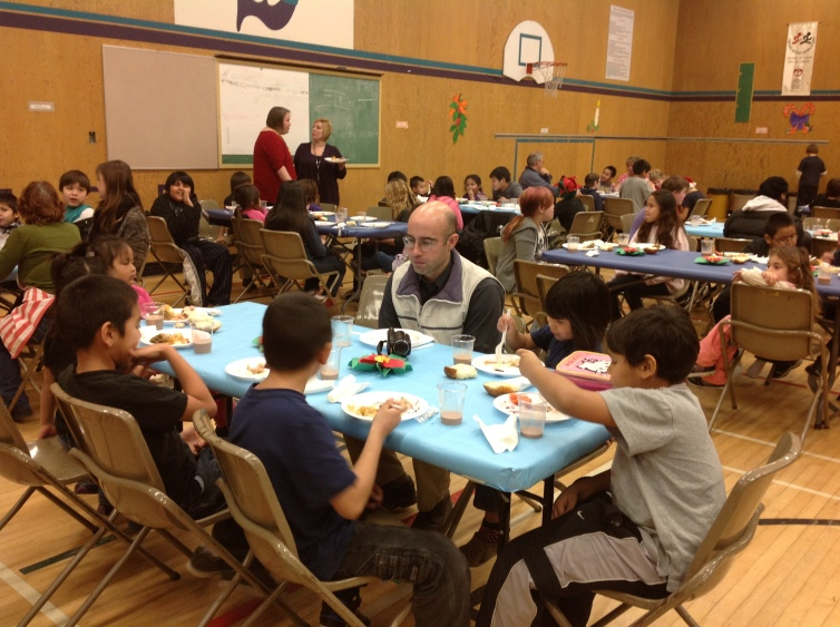 Principal Craig Munroe dines with his students at the annual Marie Sharpe Elementary turkey dinner