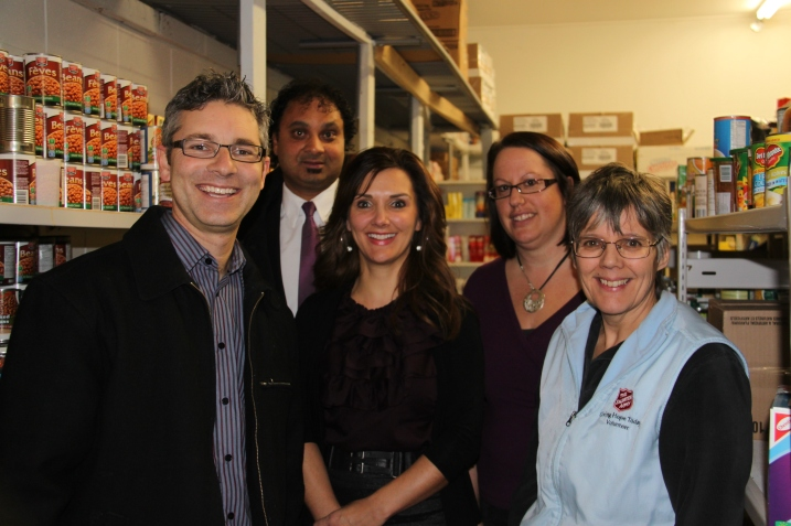 Mark Thiessen, Harj Manhas, Brandy Nasuszny (Education Division Secretary), and Shannon Rerie (Columneetza teacher) pose with Claudine Kadonga (Salvation Army Captain) at the Food Bank in Williams Lake after a donation of over $5500 from Columneetza, Williams Lake Secondary, Glendale, Nesika, and the School Board Office