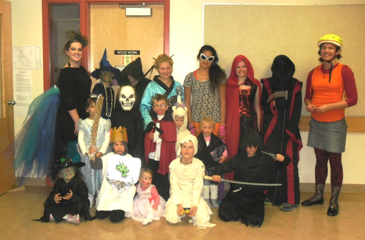 Tatla Lake School's Hallowe'en photo.  I wonder if they'll be using this for their school photo for 2012-13?  Pictured with the students are Principal Jacquline Brown and teacher France Mccoubrey.