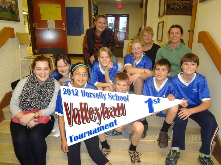 Tatla Lake School was the winner of the junior division of the recnt rural volleyball tournament after a close match against Alexis Creek.  They are pictured here with Principal Jacqueline Brown, teacher Frances McCoubrey, and parent volunteers.