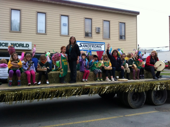 Wildwood Elementary staff, students, and parents atop their float in the Aboriginal Day parade
