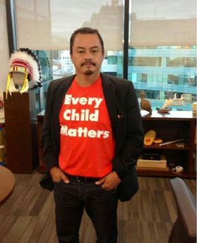 National Chief Shawn Atleo models an orange shirt.  Unfortunately, these shirts won't be available this year in School District No. 27.