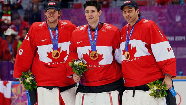 Team Canada goaltender Carey Price (centre),  flanked by teammates Mike Smith (left) and Roberto Luongo (right)