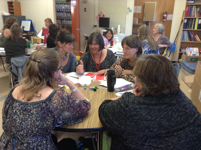 Sylvia Swift (middle) works with other teachers during a recent math cohort group meeting.  The group meets twice a month after school.
