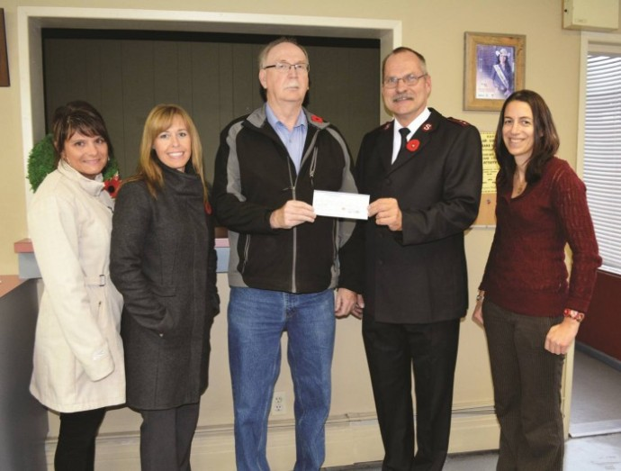 Poverty Challenge volunteers Catherine Getz, Sandee Davis, Grant MacLeod and Danielle Mader hand off a generous cheque to Williams Lake Salvation Army Captain Ben Lippers.