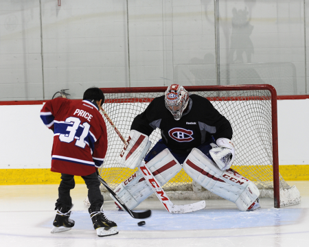 Trent Leon, a student from Anahim Lake Secondary, takes a shot on his hero, Carey Price, on a recent visit to Montreal.