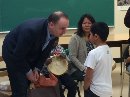 A Marie Sharpe student gave Minister Bernier a drum as a gift as Louise Harry drummed with Teacher Lorene Fennell's students.