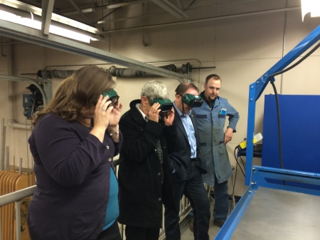 At Lake City Secondary's Columneetza Campus, Teacher Tim Westwick displayed the school's CNC Plasma cutter to Minister Bernier, MLA Barnett, and Board of Education Chair Tanya Guenther.