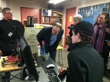 LCSS Teacher Nick MacDonald demonstrates the the 3D printer in the Tech Ed class.